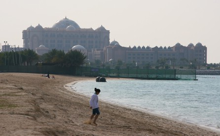 Girl on beach in front of Emirates Palace